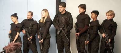 members of the Gaia team gather their weapons