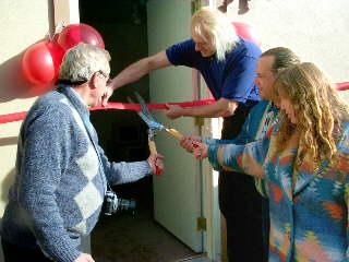 cutting the ribbon at the computer cottage